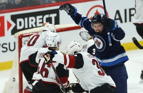 Winnipeg Jets defenceman Tucker Poolman (right) celebrates his second-period goal against the Arizona Coyotes on Monday at Bell MTS Place. (Kevin King/Winnipeg Sun)