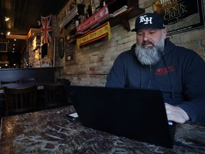 King's Head Pub owner Chris Graves works on a plan to start a grocery delivery service out of its King Street location in Winnipeg on Mon., March 30, 2020. Kevin King/Winnipeg Sun/Postmedia Network