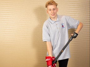 Amputee Madisson Howanyk, 20, of Winnipeg, shows off the special device he uses to hold onto a hockey stick. As April marks Limb Loss Awareness Month, amputees like Howanyk demonstrate that an amputation is not a barrier to living a full and active life.