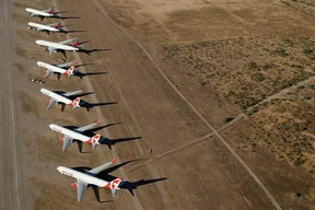 Air Canada Rouge planes, idled by COVID-19 flight restrictions, sit parked at Pinal Airpark near Tuscon, Ariz., on May 16, 2020.