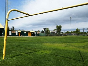 A goalpost throws a shadow onto the football field at the Old Exhibition Grounds on McPhillips Street in Winnipeg on Sun., June 7, 2020.