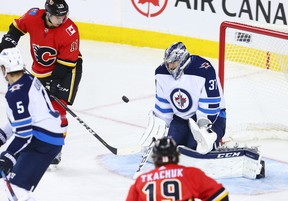 Winnipeg Jets goaltender Connor Hellebuyck stopped this Calgary Flames shot during NHL at the Scotiabank Saddleome in Calgary in 2018 with Flames forward Matthew Tkachuk on his doorstep. The two will probably see alot of each other in the qualifying series.