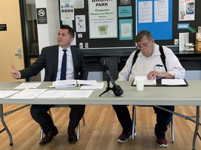 Good Neighbours lawyer, Kenneth Muys (left) and John Feldsted, chairman of the Good Neighbours Facility Working Group Committee (right) address the media, staff, and concerned residents at the Bronx Park Community Centre. James Snell/Postmedia