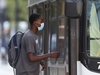 A person wears a mask while boarding a transit bus, in Winnipeg.   Friday, August 28/2020.Winnipeg Sun/Chris Procaylo/stf