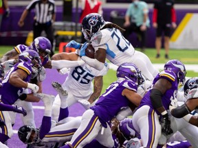 Titans running back Derrick Henry (22) scores a touchdown in the third quarter against the Vikings at U.S. Bank Stadium in Minneapolis, Sept. 27, 2020.