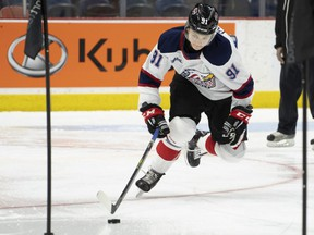 Team white centre Cole Perfetti (91) skates during the Kubota OHL/NHL Top Prospects team white on-ice skills testing in Hamilton, Ont. on Wednesday, January 15, 2020. THE CANADIAN PRESS/Peter Power
