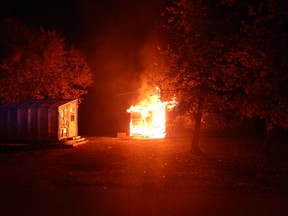 RCMP released a photo on Friday of a house fire that RCMP suspect was arson on Oct. 10 at around midnight in the town of Riding Mountain, about 30 kilometres north of Neepawa.