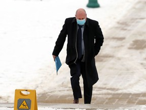 Dr. Brent Roussin, chief provincial public health officer, arrives at the Manitoba Legislative Building in Winnipeg for a press briefing on Tues., Nov. 24, 2020. Kevin King/Winnipeg Sun/Postmedia Network