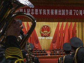 Chinese President Xi Jinping, middle, and senior members of the government stand as a the People's Liberation Army Band plays the national anthem at a ceremony marking the 70th anniversary of China's entry into the Korean War, on October 23, 2020 at the Great Hall of the People in Beijing, China.