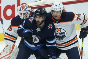 When he plays at least 60 games, Winnipeg Jets forward Mathieu Perreault (centre) has averaged 15 goals a season over a career going on 12 years, a number that's remained consistent in Washington, Anaheim and Winnipeg.Kevin King/Winnipeg Sun
