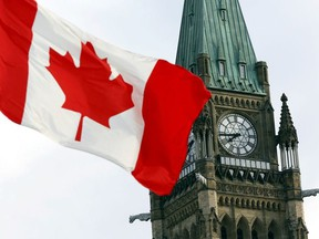 The Canadian flag flies on Parliament Hill in Ottawa August 2, 2015.