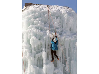 An ice climber ascends the east wall at the Club d'escalade Saint-Boniface in Winnipeg on Sunday, Feb. 21, 2021.