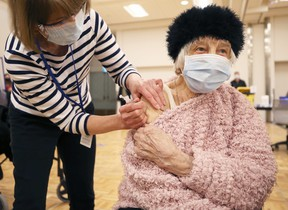 Nina Luhowy, 93, gets her shot at the COVID-19 vaccination super site at RBC Convention Centre in downtown Winnipeg on Monday, March 1, 2021.