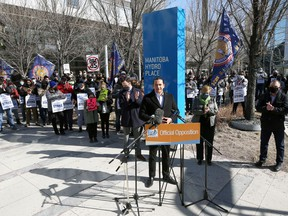 A look at the crowd gathered behind NDP Leader Wab Kinew as he speaks during a rally at Manitoba Hydro Place in downtown Winnipeg on Sunday, March 14, 2021.