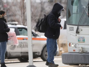 Passengers wait to board at Winnipeg Transit bus on Tuesday. There are a growing number of assaults on buses, prompting the union representing Transit workers to call for better protection.