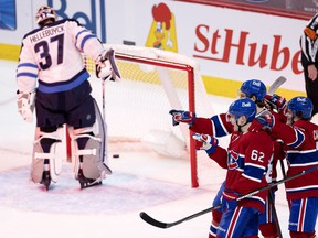 Canadiens' Artturi Lehkonen (62) celebrates scoring against Jets goaltender Connor Hellebuyck Friday night at the Bell Centre.