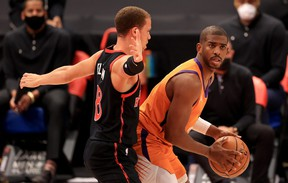 Raptors rookie guard Malachi Flynn, here guarding Chris Paul of the Phoenix Suns on March 26, 2021 should be getting more floor time with the team fading from the playoff picture.