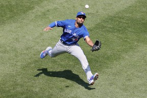 Marcus Semien of the Toronto Blue Jays makes a running catch in short right field during the fifth inning against the New York Yankees at Yankee Stadium on April 04, 2021. The Blue Jays won 3-1.
