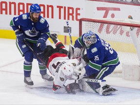 Ottawa Senators forward Brady Tkachuk (7) collides with Vancouver Canucks defenceman Jordie Benn (8) and  goalie Thatcher Demko (35) in the third period at Rogers Arena in Vancouver on Jan. 27, 2021. Vancouver won 5-1. Mandatory Credit: Bob Frid-USA TODAY Sports ORG XMIT: IMAGN-445015