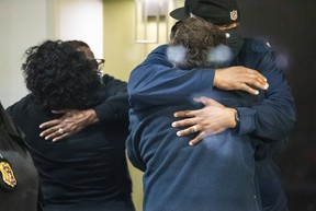 People hug after learning that their loved one is safe after a shooting inside a FedEx building Friday, April 16, 2021.