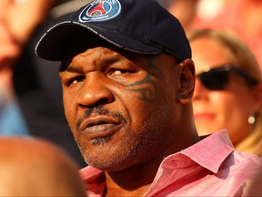 Former heavyweight boxer Mike Tyson attends the French Open at Roland Garros in Paris, June 2, 2018.