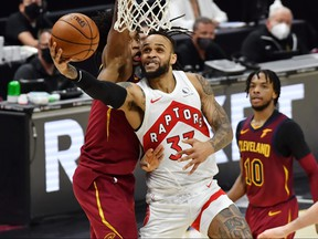 Toronto Raptors guard Gary Trent Jr., centre, drives to the basket against Cleveland Cavaliers guard Collin Sexton, left, during the fourth quarter at Rocket Mortgage FieldHouse in Cleveland, Ohio, April 10, 2021.