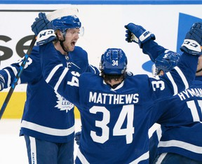 Auston Matthews (centre) celebrates with Toronto Maple Leafs teammates after a goal against the Montreal Canadiens on Saturday in Toronto.