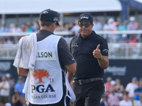 Phil Mickelson gives a thumbs-up to his caddie after playing a shot on to the 18th green during the third round of the PGA Championship at Kiawah Island Resort's Ocean Course on Saturday in Kiawah Island, S.C.