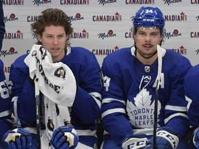 Maple Leafs' Mitch Marner (left) and Auston Matthews (centre) take a break during a stoppage in play in the third period against the Montreal Canadiens at Scotiabank Arena.