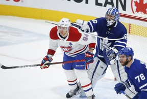 Montreal Canadiens Corey Perry and Toronto Maple Leafs Jack Campbell get into it in front of the net during first period action in Toronto on May 6, 2021.