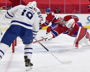 Montreal Canadiens goalie Carey Price dives for the puck on a shot from Toronto Maple Leafs forward Jason Spezza during their playoff game at the Bell Centre Monday night.USA TODAY SPORTS