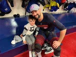 Nate Thompson and his son, with his son, Teague, at the Habs practice facility. Stu Cowan/Postmedia