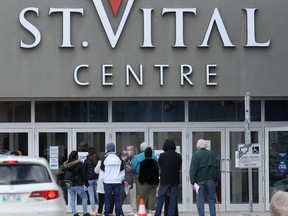 People line up to enter a shopping centre in Winnipeg.   Tuesday, May 04, 2/2021.Winnipeg Sun/Chris Procaylo/stf
