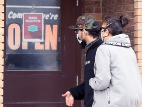 People enter a restaurant on Isabel Street in Winnipeg on Thursday, May 20, 2021.