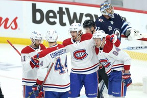 Montreal Canadiens centre Eric Staal (centre) celebrates his goal during Game 1 of the North Division final against the Winnipeg Jets in Winnipeg on Tuesday