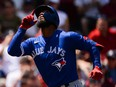 Teoscar Hernandez of the Toronto Blue Jays celebrates after hitting his second home run of the day in the fourth inning against the Boston Red Sox at Fenway Park on June 13, 2021 in Boston.