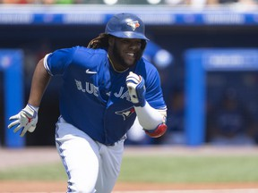 Toronto Blue Jays first baseman Vladimir Guerrero Jr. (27) runs out an RBI single during the third inning against the Baltimore Orioles at Sahlen Field n Buffalo on Sunday, June 27, 2021.