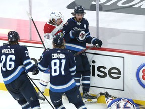 Winnipeg Jets centre Mark Scheifele (top right) reacts as Montreal Canadiens centre Jake Evans lays on the ice following his hit late in Game 1 of the North Division final in Winnipeg on Wed., June 2, 2021. KEVIN KING/Winnipeg Sun/Postmedia Network
