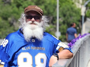 Larry Baille will tightly grip his dad's police badge as he sheds more than a year's worth of beard and runs a half marathon trek Tuesday past local milestone locations that marked his father's final year of life.