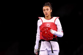 Skylar Park of Team Canada reacts after being defeated by Lo Chia-ling of Team Chinese Taipei during the Women's -57kg Taekwondo Quarterfinal contest on day two of the Tokyo 2020 Olympic Games at Makuhari Messe Hall on July 25, 2021 in Chiba, Japan. (Photo by Maja Hitij/Getty Images)