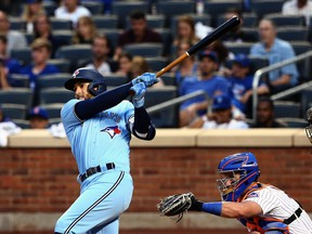 Toronto Blue Jays centr- fielder George Springer hits a solo home run against the New York Mets during the third inning at Citi Field in New York City, July 24, 2021.