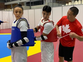 Taekwondo athlete Skylar Park (left) is supported by her younger brother, Tae-Ku, and father and coach, Jae, at the Tokyo Olympics.