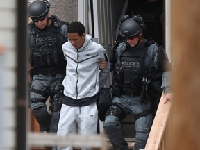 Heavily armed police took numerous people into custody from a residence in the vicinity of Dufferin Avenue and McGregor Street in Winnipeg on Thursday, July 8, 2021.