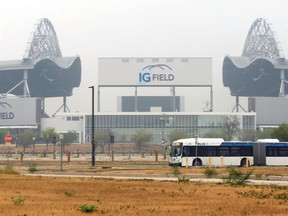 A bus passes IG Field in Winnipeg on Tuesday, July 20, 2021. The Winnipeg Blue Bombers cancelled its training camp session due to poor air quality from forest fires.