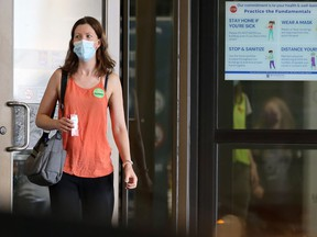 A woman exits the COVID-19 vaccination site at RBC Convention Centre in Winnipeg on Tuesday, July 27, 2021.