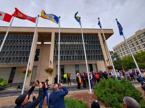 Representatives from the Dakota Nations, Metis Nation and Treaty One First Nations gathered at Winnipeg city hall on Wednesday to permanently raise their flags.  James Snell/Winnipeg Sun