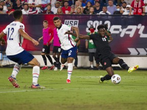Alphonso Davies (No. 19) of Canada crosses the ball to set up a Canada goal against the United States during the second half of a World Cup qualifying match at Nissan Stadium on September 5, 2021 in Nashville, Tennessee.