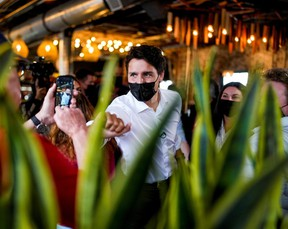 Prime Minister Justin Trudeau greets supporters during an election campaign stop at The Picaroons Roundhouse in Fredericton, New Brunswick, September 15, 2021.