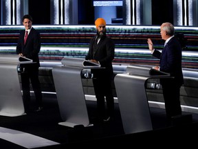 From left to right, Liberal Leader Justin Trudeau, NDP Leader Jagmeet Singh, and Conservative Leader Erin O'Toole take part in the English-language Leaders debate in Gatineau, Que., Sept. 9, 2021.