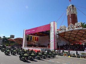 Members of the army participate in the national day celebration in Taipei, Taiwan, Sunday, Oct. 10, 2021.